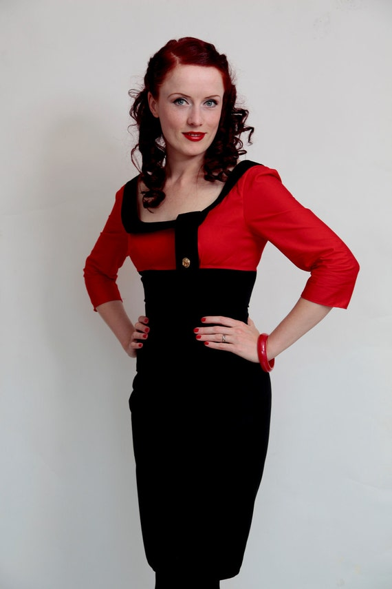 1950s inspired bombshell dress in black, navy, red and white with nauticalanchor button detail