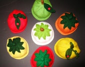 A set of 2 fruit and veggie hats, for newborn to 3 months