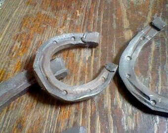 Hand forged iron mini horseshoes