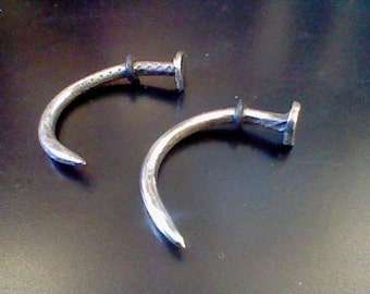 Hand forged stainless steel curled nail - 8 gauge