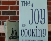 The Joy of Cooking Happens Here Distressed Vintage Style Sign
