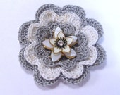 Hand made crochet brooch pin flower with antique vintage earring center.