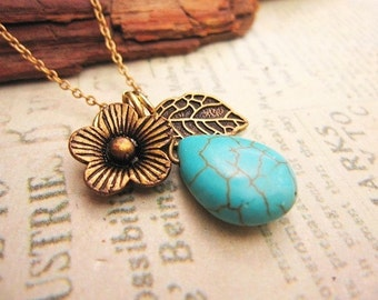 Teardrop Turquoise Stone Necklace adorned with flower and leaf charm