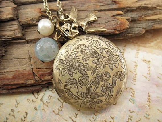 Breeze. a locket necklace with blue agate stone, pearl and bird charm accent