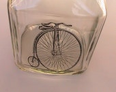 Fun Little Jar with Old Cycle and a Shiney Black Lid -Store Your Jelly Beans