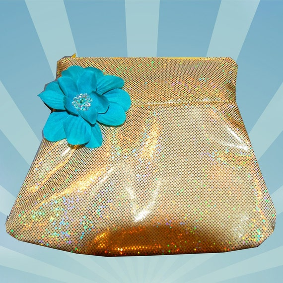 Gold makeup bag with a teal flower