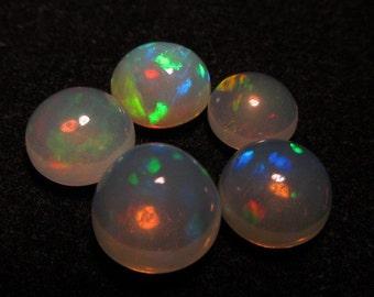 9 - 7  mm Ethiopian Opal really high quality CABOCHON Round shape each pcs - have amazing - beautifull - flashy fire -5 pcs