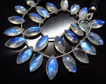 aaa very nice  quality gorgeous rainbow moonstone smooth marquise shape each pcs blue flashy rainbow fire size 6x12 mm to 7x14 mm 25 pcs