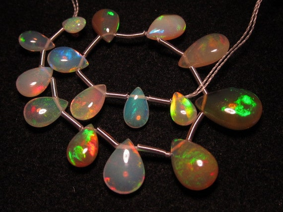 15pcs- AAAAA -High Quality Every Pcs Have Full Amazing Fire Inside Ethiopian Opal Smooth polished Pear Briolett size 4x6.5 - 7x11 mm