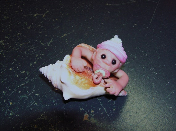 polymer clay sculpt, baby in a shell, sucking on pacifier,OOAK sculpt, polymer baby,