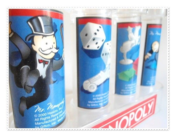 Monopoly Game Graphics on Money Coin Sorter Tube Bank - Watch Your Savings Grow