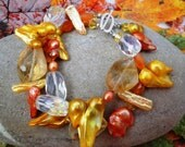 Bracelet, citrines, blister pearls, carnelians, Swarovski crystals, two strands of Indian Summer shaded gemstones and pearls Jewelry by Ocean Phoenix Designs