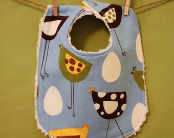 The Dressy Drooler Bib in Blue Metro Market Chicks