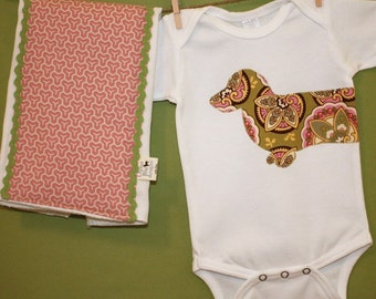 Dachshund bodysuit and burp cloth gift set in star paisley and pink honeycomb prints