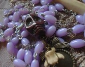Lavender Rosary with skull bead and real  bone