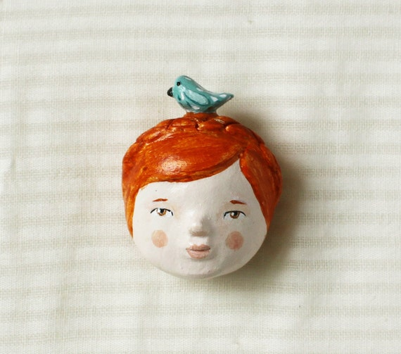 FREE SHIPPING  Redhead doll face and bird - ooak brooch - wearable art - sculpted paper clay pin
