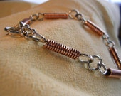 silver and copper coil bracelet