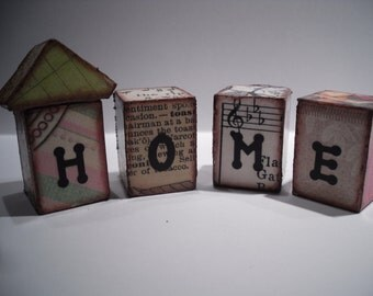 Ephemera houses ...  Wood blocks that spell out home.. vintage paper..old stamps.. funky home decor..altered art house