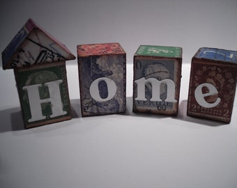 Ephemera houses ...  Wood blocks that spell out home.. vintage postage stamps.. funky home decor..awesome from every side