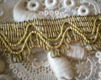 1 yard of high metal content  antique gold trim, old store stock,more avail.
