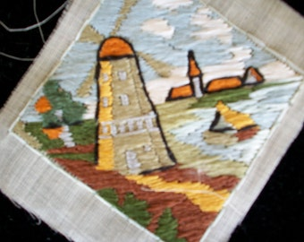 Antique hand loomed applique of a scene in Holland