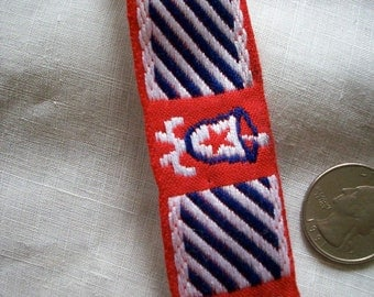 Vintage cotton red ,white, and navy blue trim