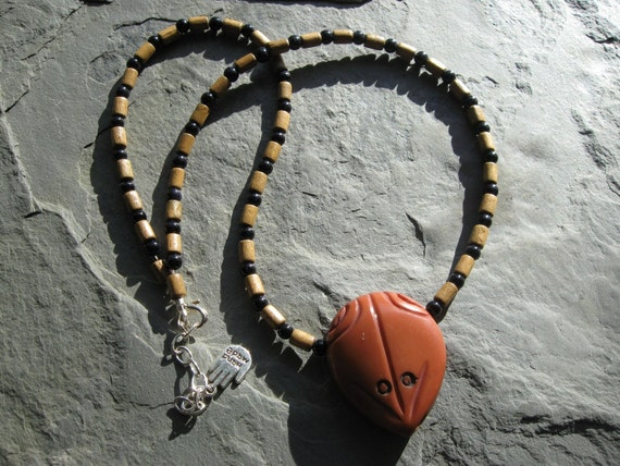 frog pendant on a wood beaded necklace