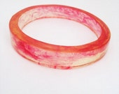 Resin bangle bracelet jewellery in red and yellow zigzag for petite hands by TopazTurtle on Etsy