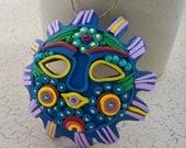 Mexican sun mask colorful ornament in polymer clay