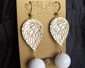 Golden leaf and white marble earrings.