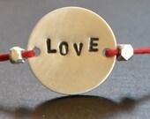 WORD bracelet  oOo Hand stamped - LOVE - bracelet sterling silver on RED Irish Linen
