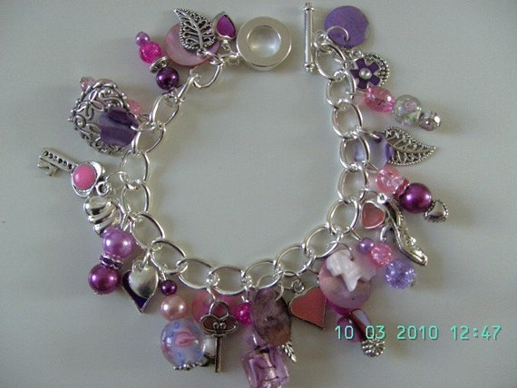 Handmade Gorgeous Pink, Purple, silver charms Bracelet by NewellsJewels on etsy