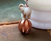 A Balancing Act.... vintage elephant pendant necklace....