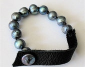 UNUSUAL Leather and pearl bracelet
