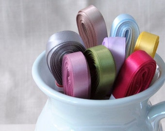 10 yards of double-sided satin ribbon, 1 roll, available in: pink, blue, green, lilac, purple, yellow, latte, grey or black