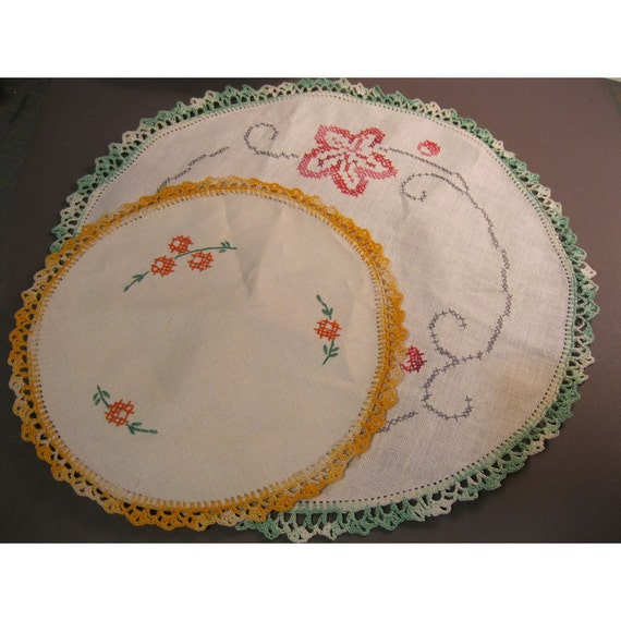SALE - 2 vintage linen doilies with crocheted trim and cross stitch flowers