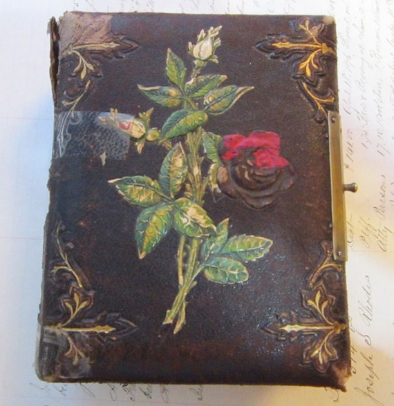 empty antique tintype CDV album - leather cover with embossed ROSE motif - has damage, great for altered art, paper arts, heritage art