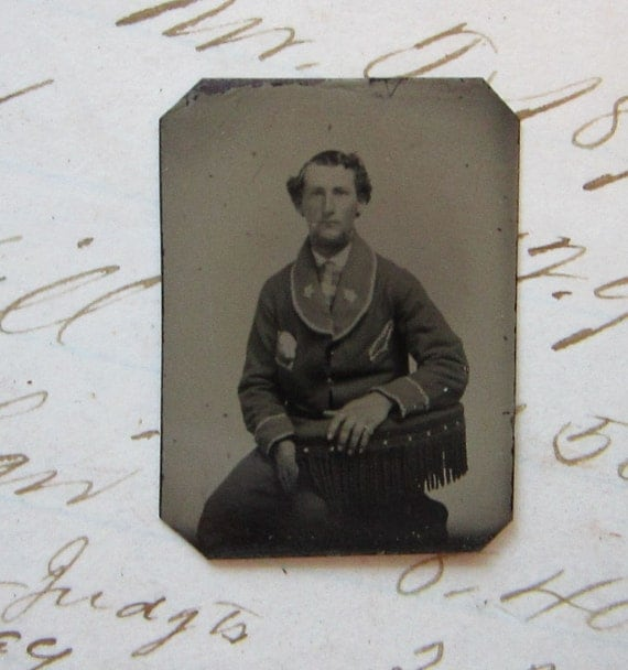 tiny antique gem TINTYPE photo - man in uniform, sitter, seated - GTD16a