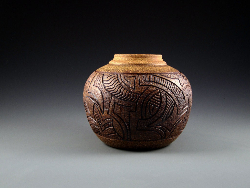 Hand carved and textured pottery