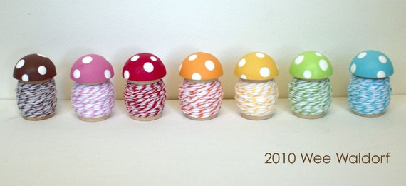 Wee Toadstool Spools Set. With stripey twine. New edition. Full set. Seven colors.