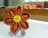 name badge holder with fabric flower in burnt orange color