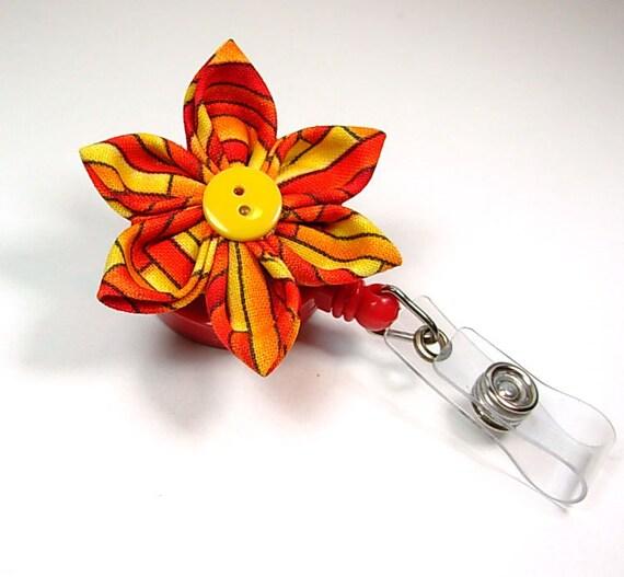 orange star flower ID badge reel