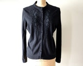 vintage 1960s sweater: black noir embroidered 60s cardigan sweater