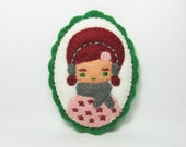 Girl wearing earmuffs felt pin