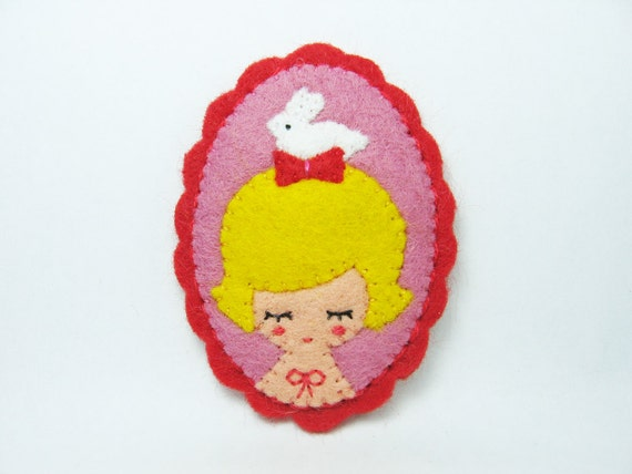 A girl and her candy rabbit felt pin