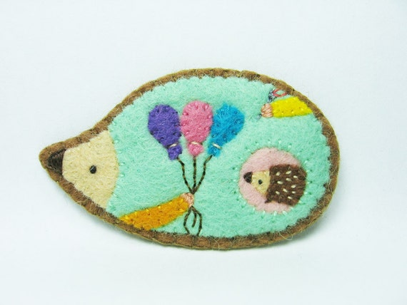 Wishes of a playful hedgehog felt pin
