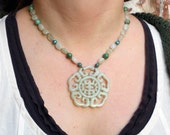 Jade and magnesite necklace with large carved jade pendant.