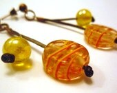Yellow sunny earrings in leather and glass beads