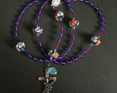 RESERVED for bikebetty -- tropical punch lampwork and glass rosary