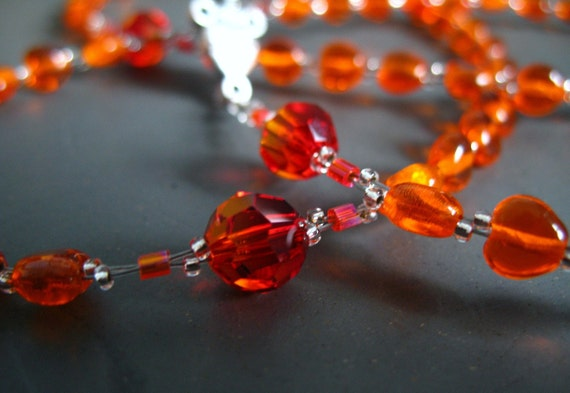 rosary beads -- fire opal and hyacinth hearts